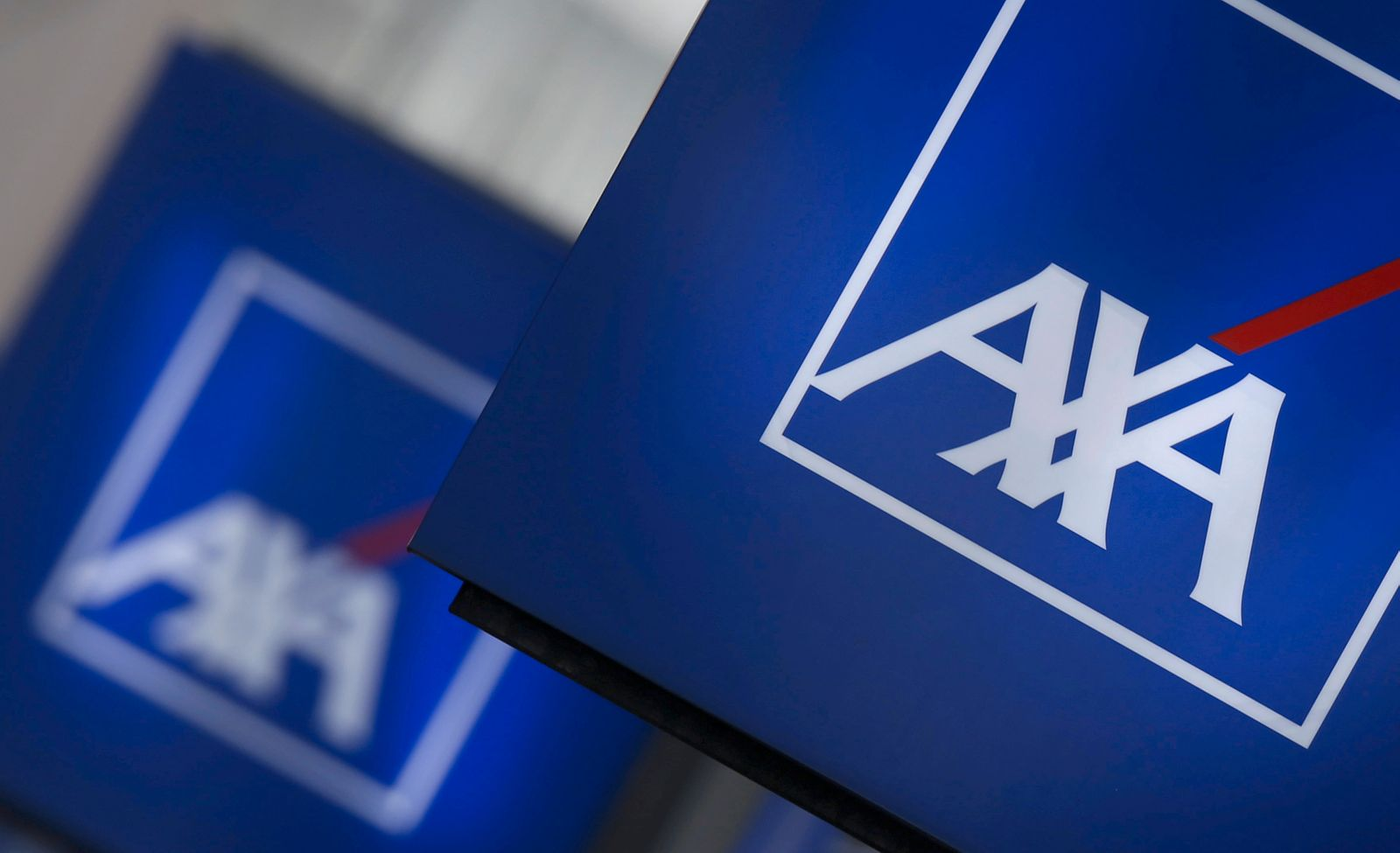 File photo of logos of France's biggest insurer Axa are seen on a building in Nanterre
