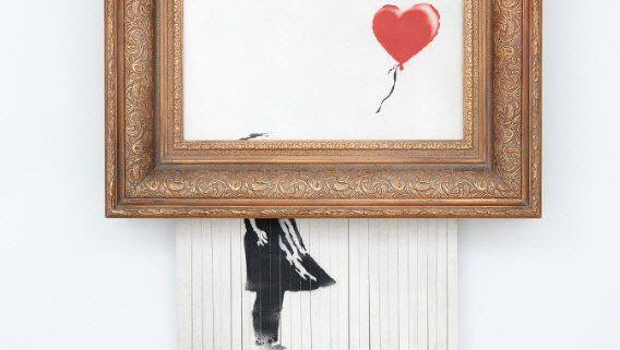"""Banskys """"Girl with a Balloon"""": Die Käuferin zahlte 1,2 Millionen Euro - für ein Kunstwerk, dass sich kurz nach dem Kauf selbst zerstörte"""
