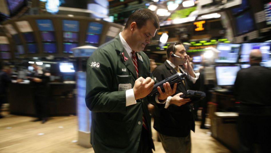 Aktienhändler in New York: Die Börse fiebert der US-Zinswende entgegen