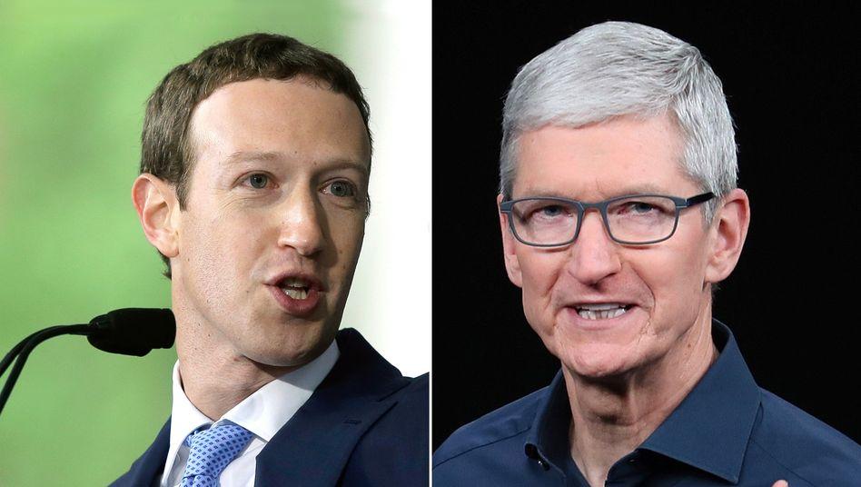 Duell der Giganten: Facebook-Chef Mark Zuckerberg wehrt sich mit allen Mitteln gegen die neuen Datenschutzregeln von Apple-CEO Tim Cook