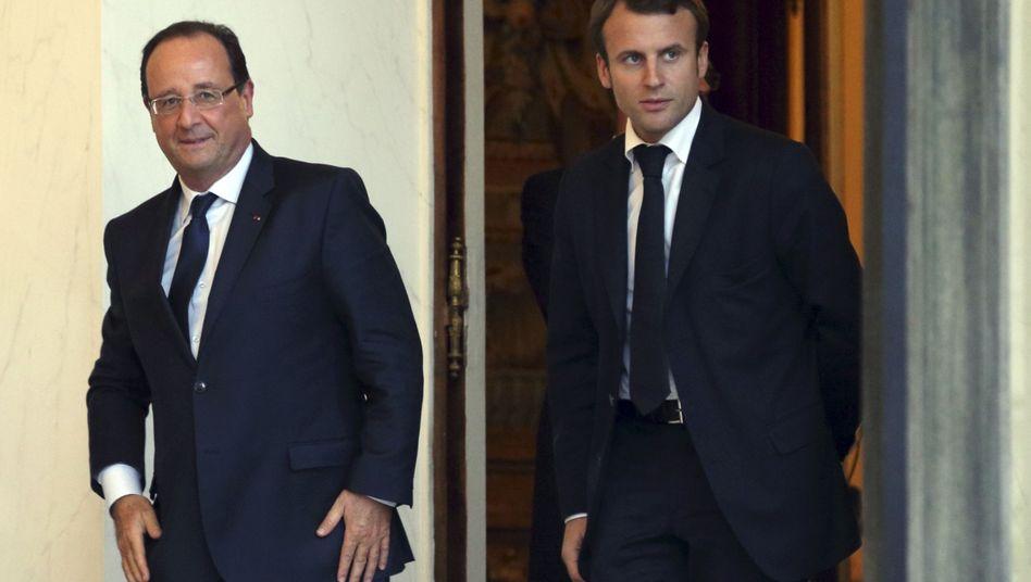Hollande (links), neuer Wirtschaftsminister Emmanuel Macron: Die Störfeuer gegen den Sparkurs dürften auch nach der Regierungsumbildung weiter gehen