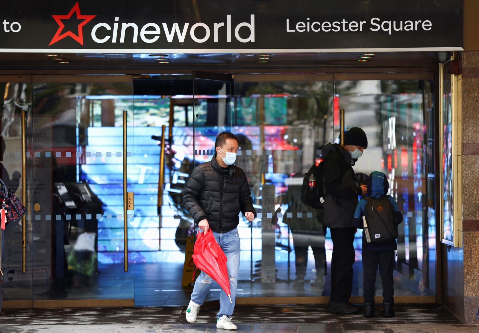 People are seen at a Cineworld in Leicester?s Square in London