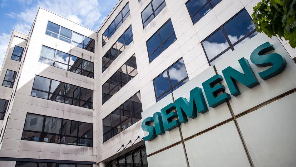 Siemens: In der kommenden Woche verkündet Konzernchef Joe Kaeser die Jahresbilanz - und nennt möglicherweise auch einen Käufer für die Hörgeräte