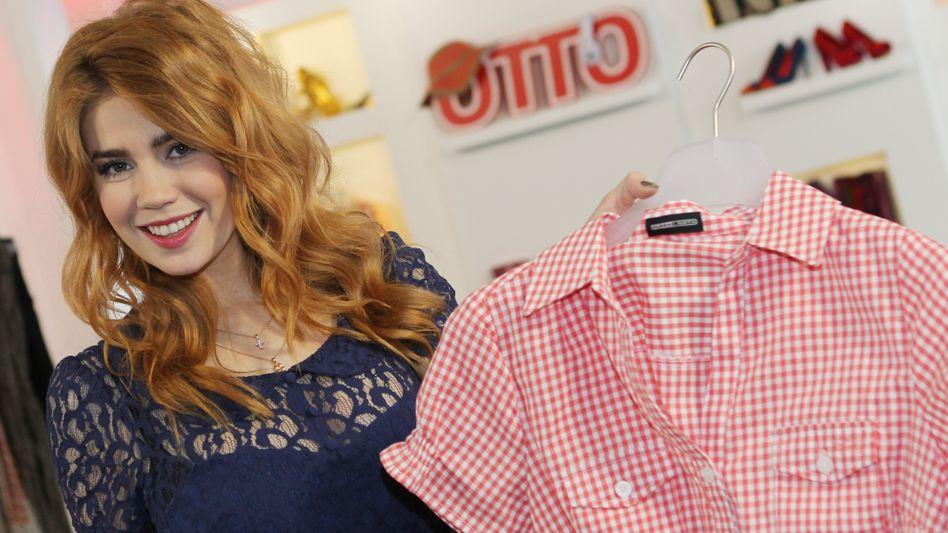 Otto-Model Palina Rojinski: Die Versandhandelsgruppe wird im Geschäftsjahr 2011/12 wohl nur einen mageren Gewinn von 200 Millionen Euro einstreichen