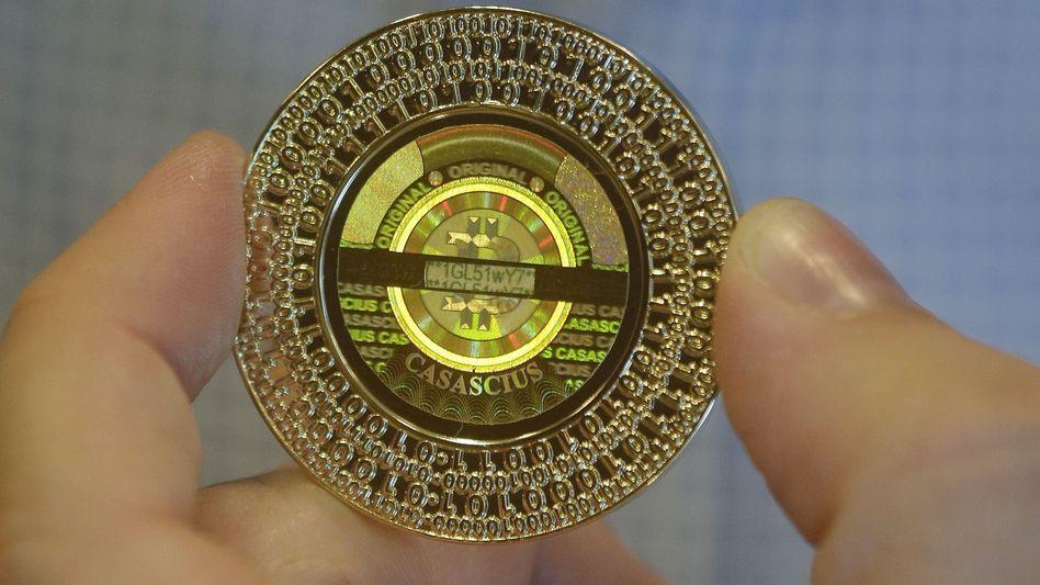 Und wieder abgestürzt: Die Kryptowährung Bitcoin scheitert nach einem rasanten Aufstieg am Rekordhoch und bricht ein