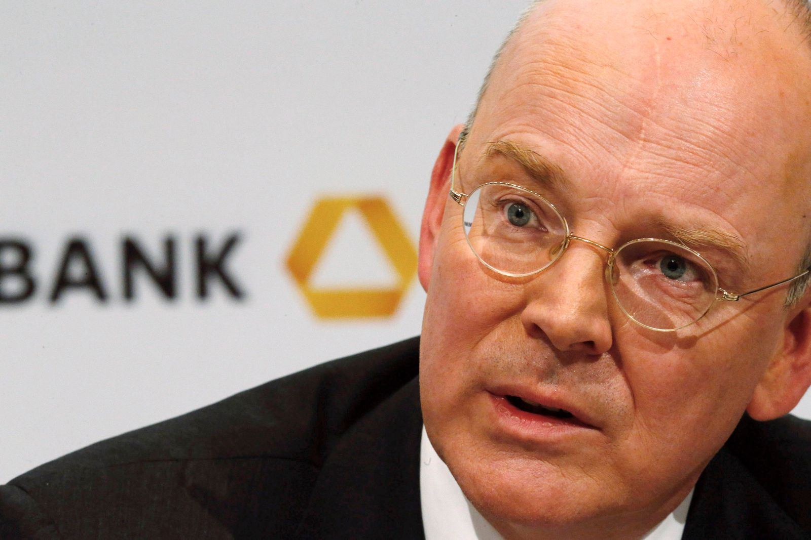 Commerzbank Chief Executive Blessing listens during the bank's annual news conference in Frankfurt