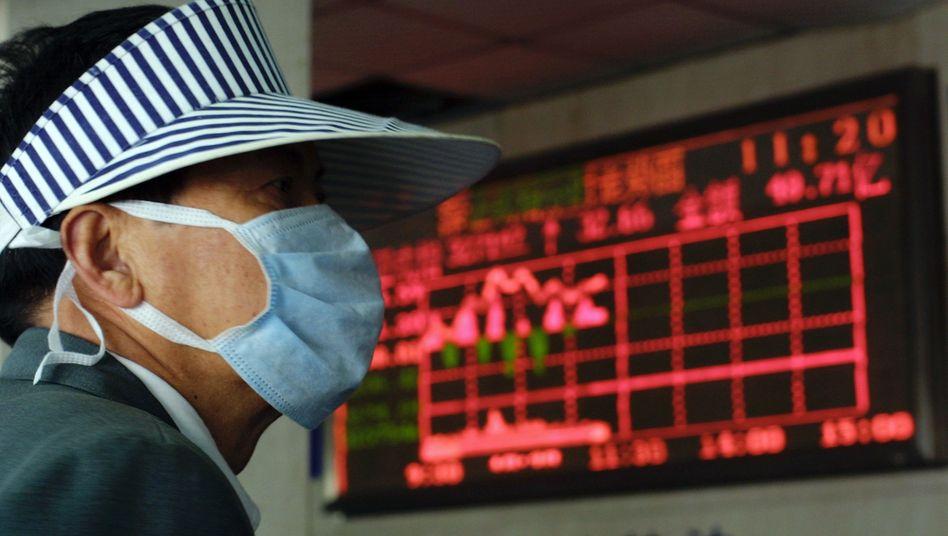 Unschöne Erinnerungen: Auch 2003 verursachte die Krankheit SARS ausgehend von China Verunsicherung weltweit sowie Kursverluste an der Börse. Wird sich die Lage angesichts des Coronavirus' ähnlich entwickeln?
