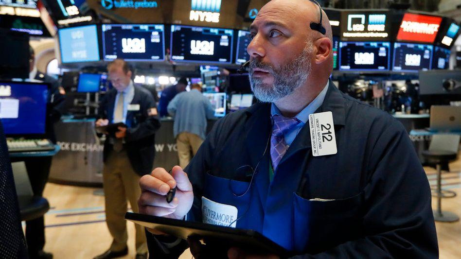 Aktienhändler in New York: Hoffnungen auf Entspannung im Handelsstreit lassen einmal mehr die Kurse steigen.