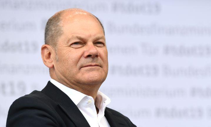 """""""Noch Aufgaben aus der Wiedervereinigung zu stemmen"""" : Finanzminister Olaf Scholz verteidigt, dass Reiche weiter den Soli zahlen sollen"""