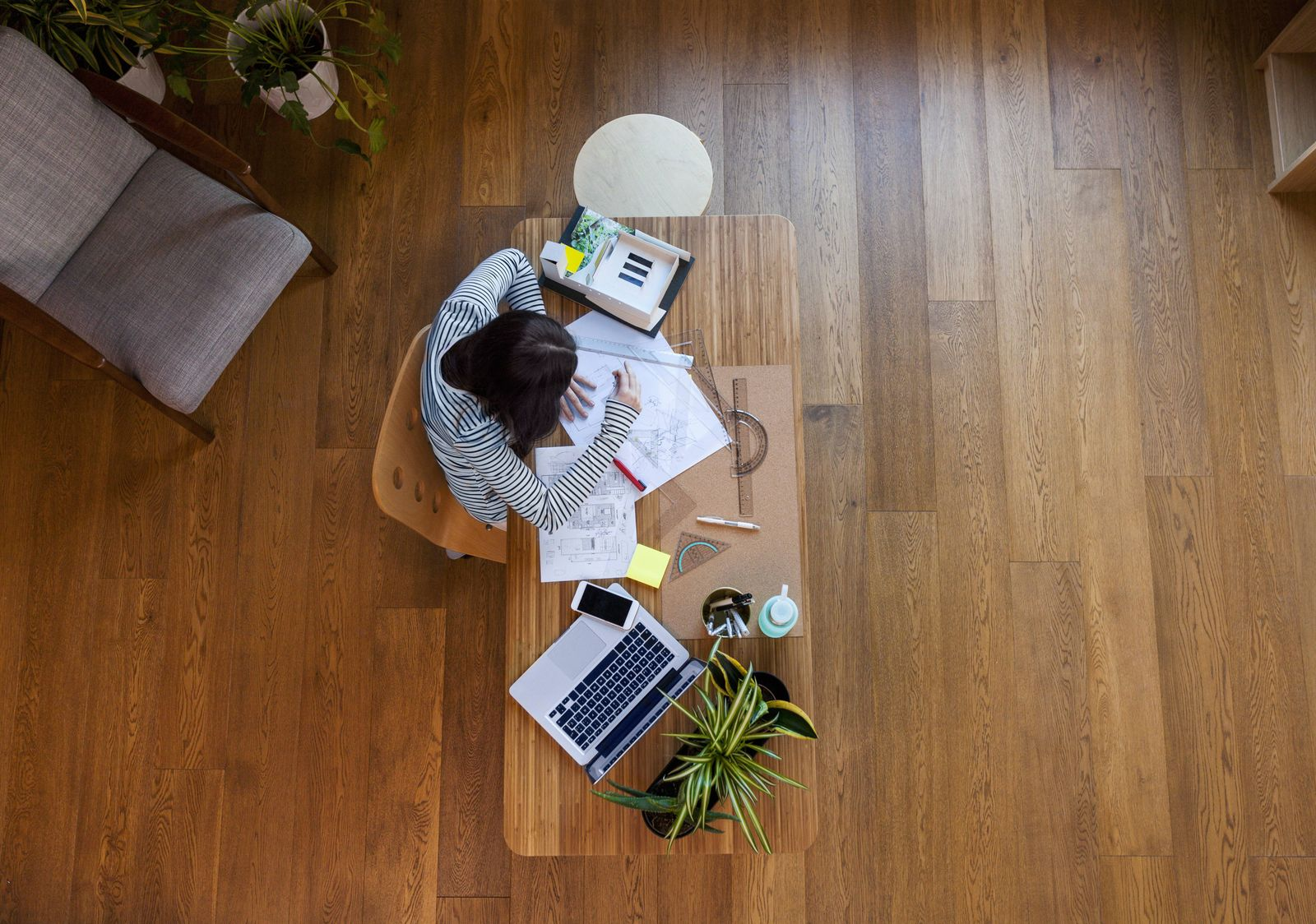 Young architect working in office from directly above model released Symbolfoto property released P