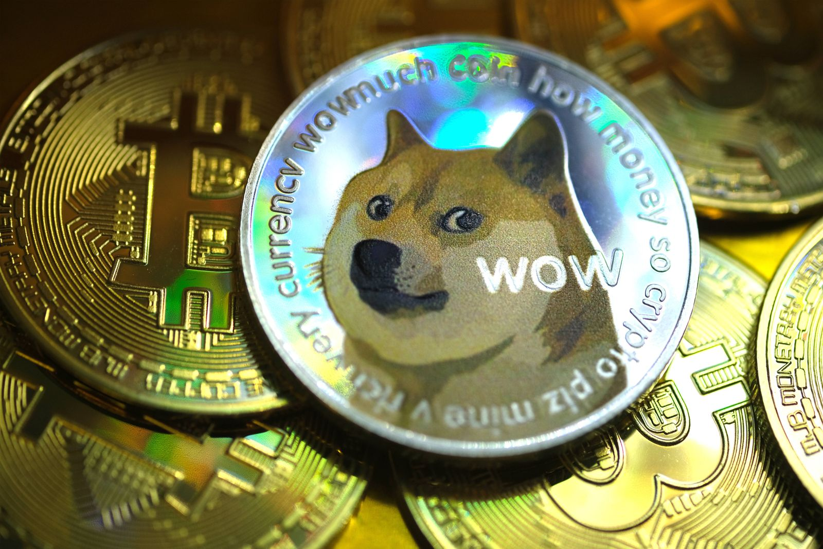 In this photo illustration, visual representations of digital cryptocurrencies, Dogecoin and Bitcoin, are arranged on Ja