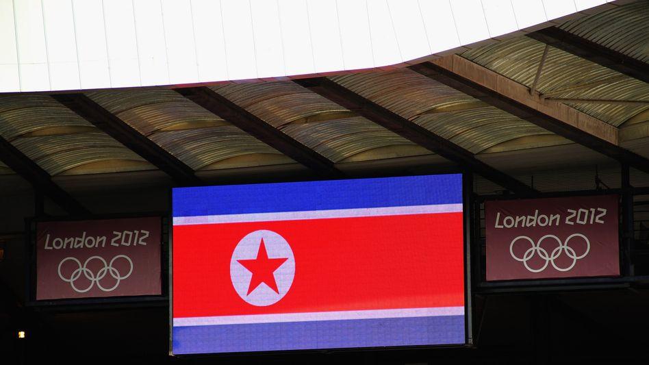 Panne bei Olympia: Erst eine Stunde später gelang es den Organisatoren, die richtige Flagge von Nordkorea (im Bild) anzuzeigen