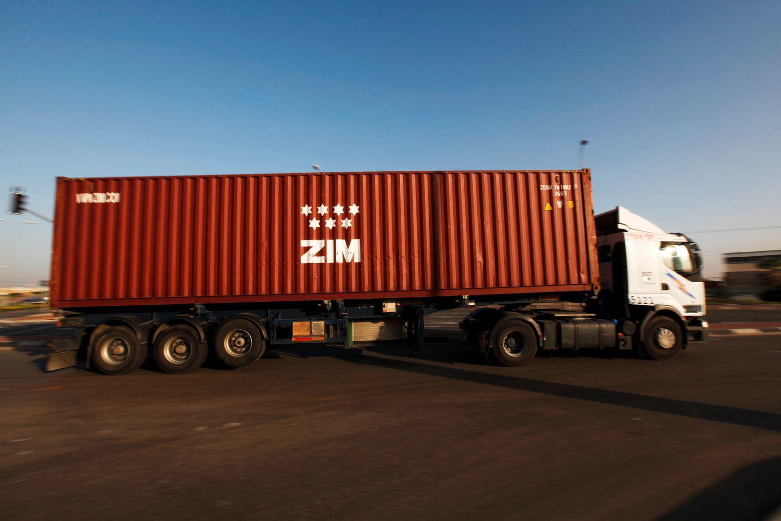 A truck transports a Zim container just outside Israel's port of Ashdod