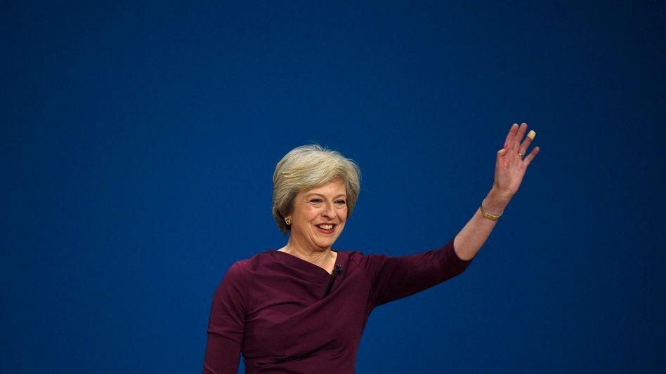 Wird für ihren harten Kurs gefeiert: Premier Theresa May Anfang Oktober auf dem Parteitag ihrer Konservativen.
