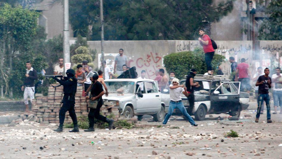 Straßenschlacht in Nasr City: Mindestens 70 Menschen starben bei den gewaltsamen Auseinandersetzungen am Sonnabend