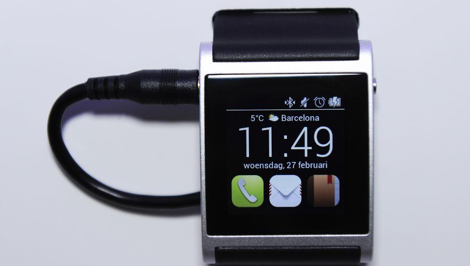 Apple-Uhr (auf dem Mobile World Congress 2013): Anziehungskraft als Statussymbol