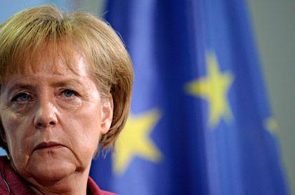 Erste Hürde genommen: Das Bundeskabinett von Kanzlerin Merkel hat das Euro-Paket abgenickt