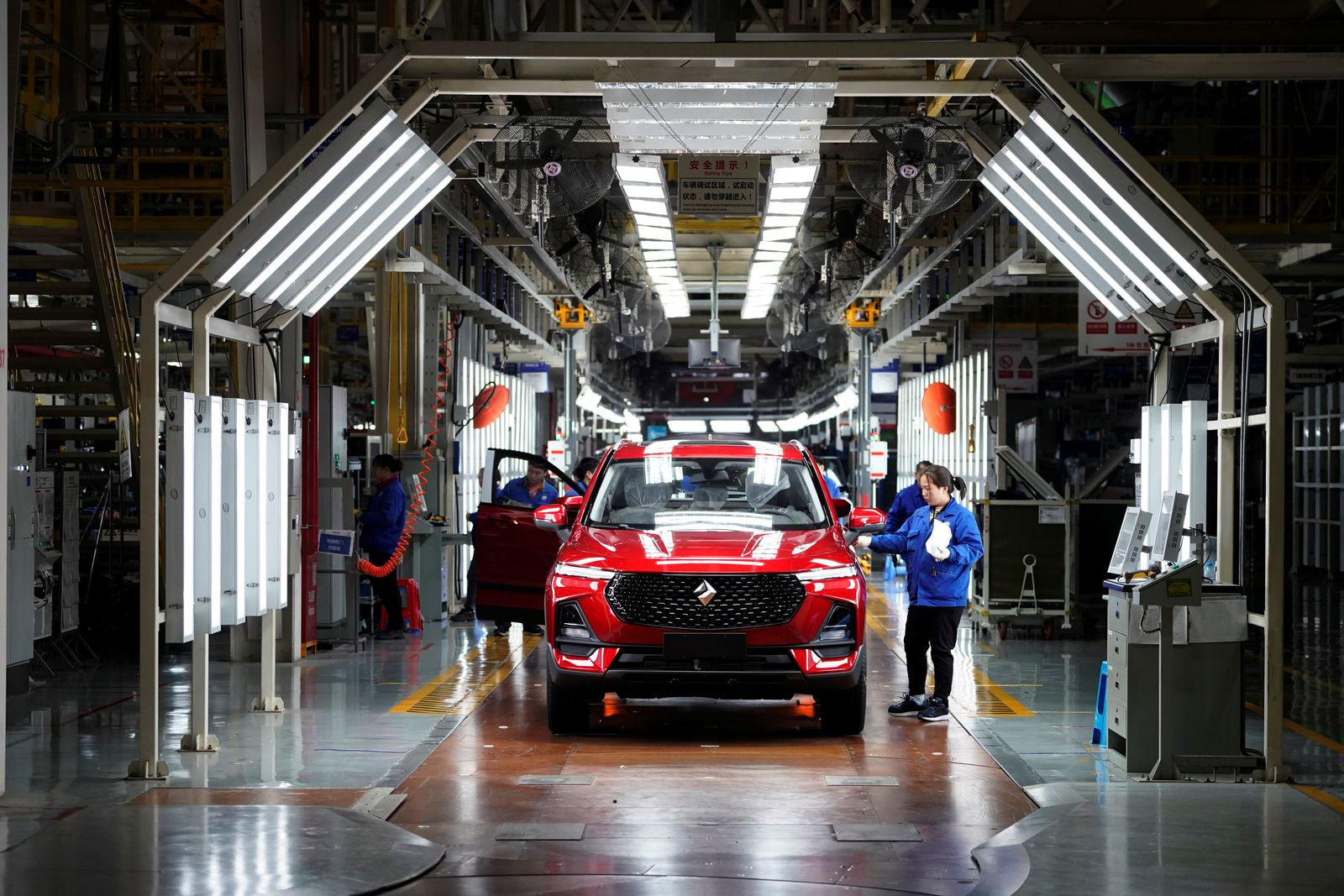 Employees work on Baojun RS-5 cars at a final assembly plant operated by General Motors Co and its local joint-venture partners in Liuzhou