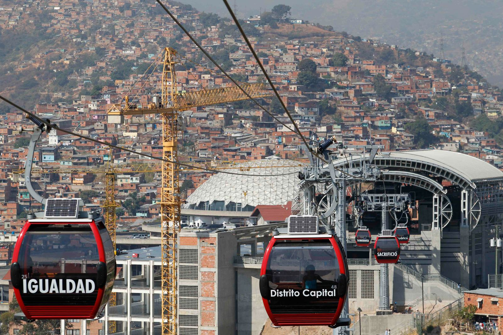 Metrocable cabins are seen as they travel in Caracas