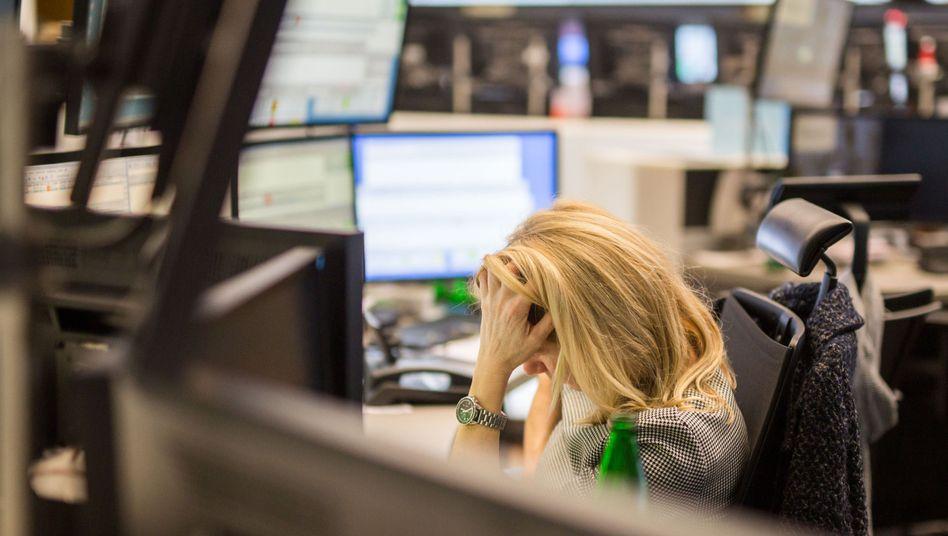 Bild der Verzweiflung? Aktienhändlerin an der Börse Frankfurt.