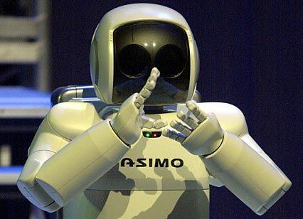 """Der Roboter """"Asimo"""": applaudiert nach seiner Vorstellung dem Publikum zu"""