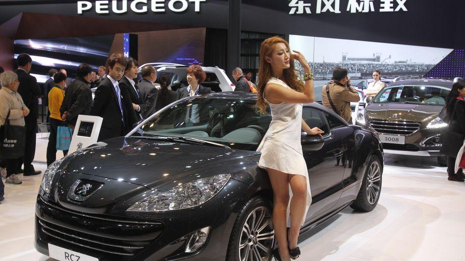 Peugeot-Stand bei einer Automesse im Jahr 2013: Aktuell kann sich PSA in China nicht gerade in Pose werfen