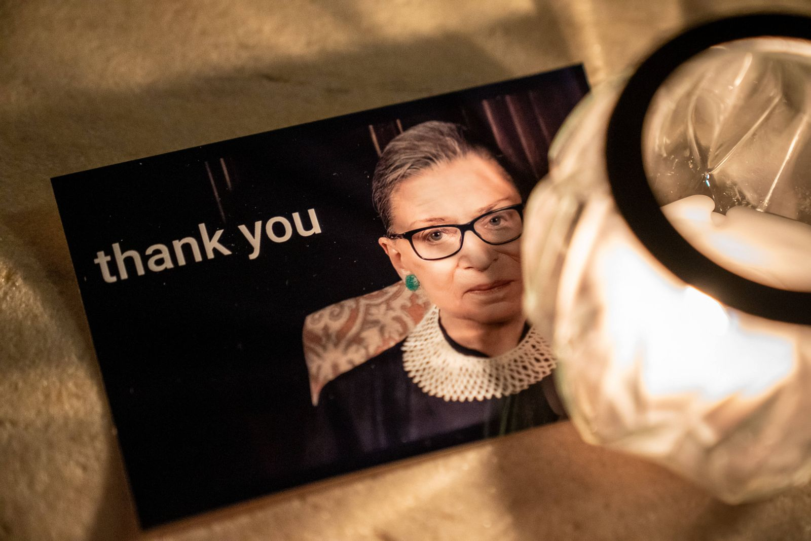 A card thanking Associate Supreme Court Justice Ruth Bader Ginsburg lays on the steps of the United States Supreme Cour