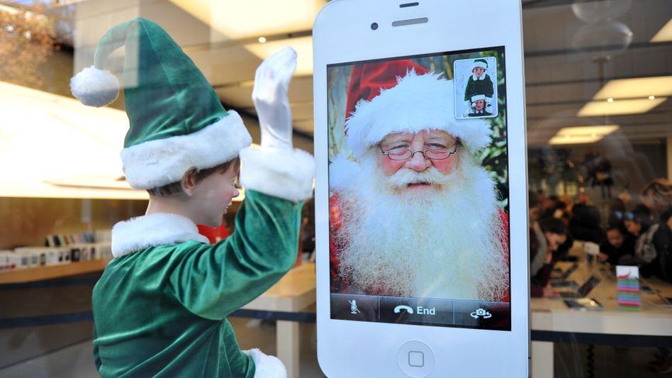Apple Store in München (Bild Archiv): Im wichtigen Weihnachtsgeschäft soll es dieses Jahr für Apple besser laufen als im vergangenen Jahr