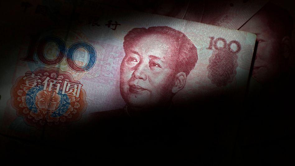 Auf dem Weg zum Weltgeld: Rote Banknoten mit Mao-Porträt