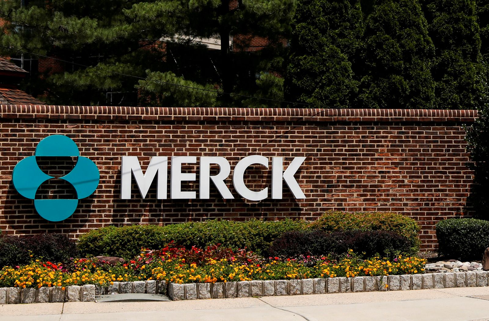 FILE PHOTO: The Merck logo is seen at a gate to the Merck & Co campus in Linden, New Jersey