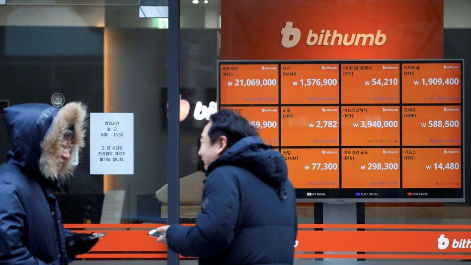 Zur Börse oder zum Arzt? Laut Barclays ist der Bitcoin-Hype vergleichbar mit einer Grippewelle.