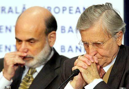 Fed-Chef Ben Bernanke (l): Die US-Notenbank erwartet einen Abschwung 2009. Die Zinsen könnten schon im Dezember unter das aktuelle Niveau von 1 Prozent gedrückt werden. Der Dow stürzt dennoch ab