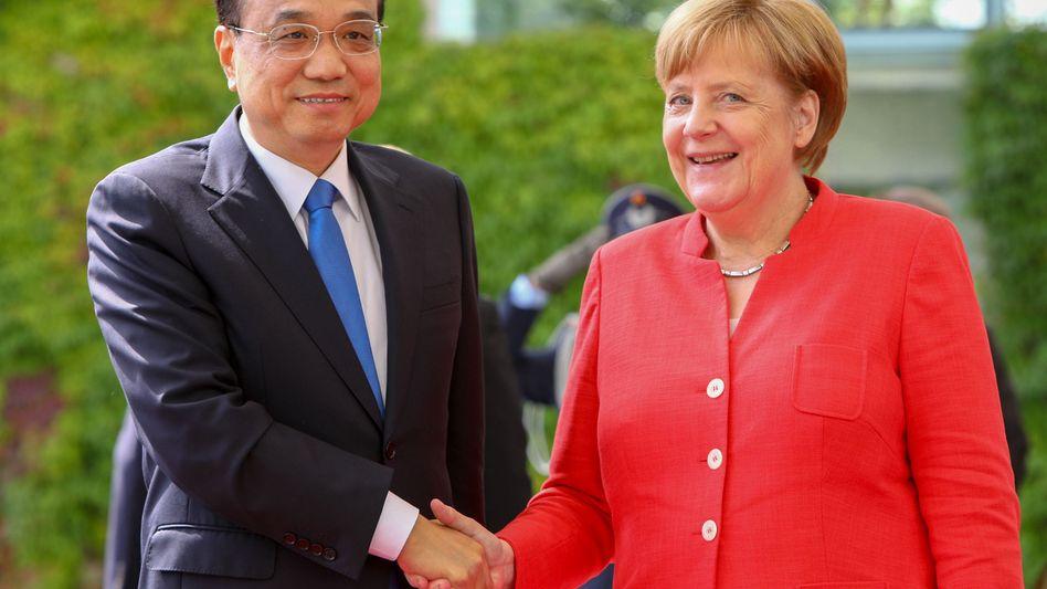 Reden wohl auch über Trump: Kanzlerin Merkel und Chinas Ministerpräsident Li Keqiang