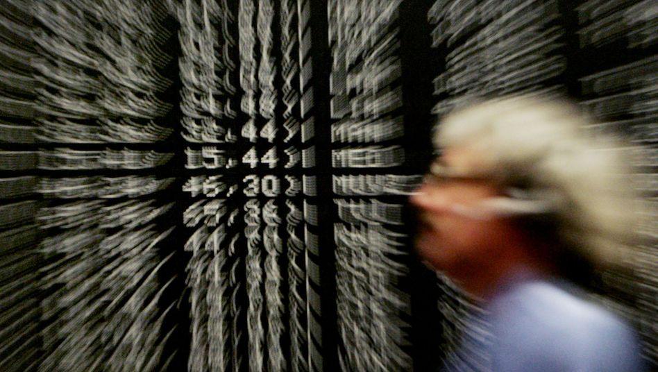 Händler an der Deutschen Börse in Frankfurt: Unter den Indizes sorgte vor allem der MDax am Montag für Schlagzeilen