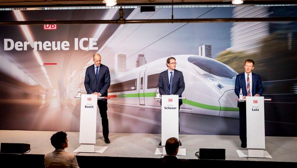 Siemens-Vize Roland Busch, Verkehrsminister Andreas Scheuer und Bahnchef Richard Lutz (von links) am Mittwoch in Berlin