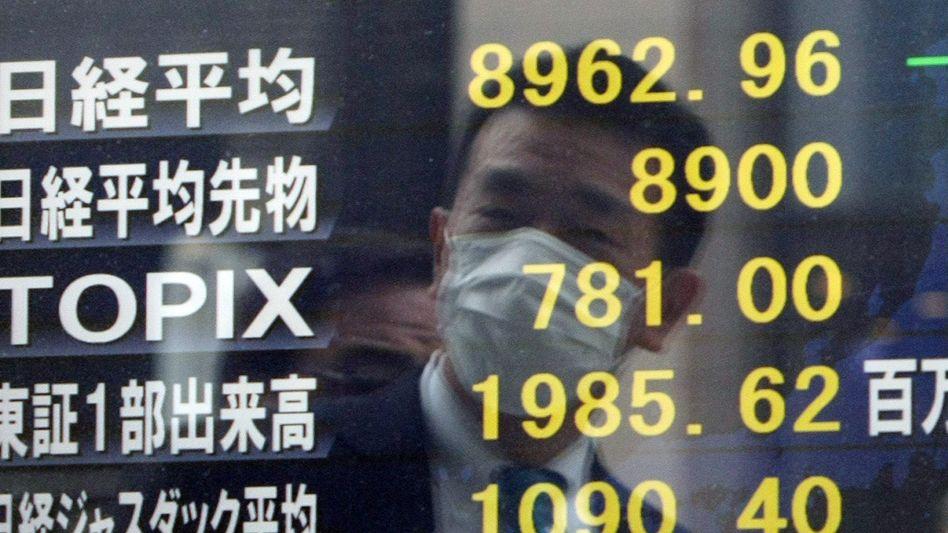 Angst vor Radioaktivität: Die Anleger in Tokio reagierten mit Verkäufen auf die neue Eskalation im Atomkraftwerk Fukushima