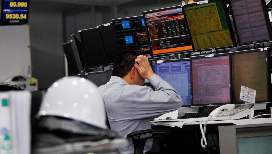 Es wird warm in Tokios Büros: Unternehmen müssen per Verordnung im Sommer Strom sparen