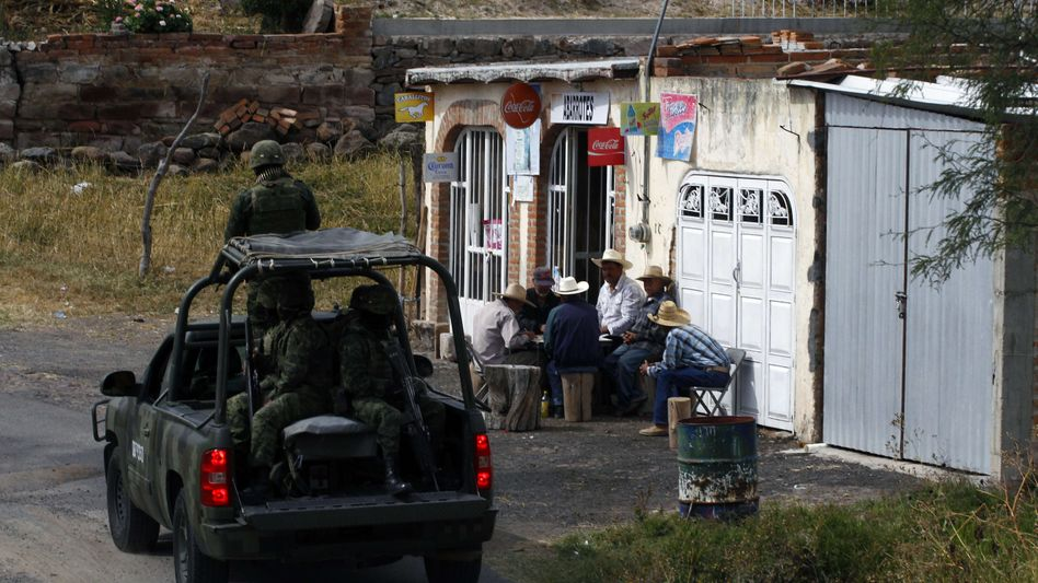Mexican soldiers patro the area after finding a clandestine chemical drug processing laboratory in a cave in the mountains of Yahualica, Jalisco. More than 70,000 people have been killed in rising drug-related violence in Mexico since December 2006, when President Felipe Calderon deployed soldiers and federal police to take on organized crime.