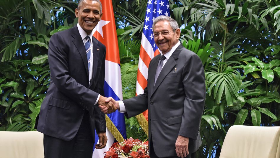 US President Barack Obama (L) and Cuban President Raul Castro shake hands during a meeting at the Revolution Palace in Havana on March 21, 2016.