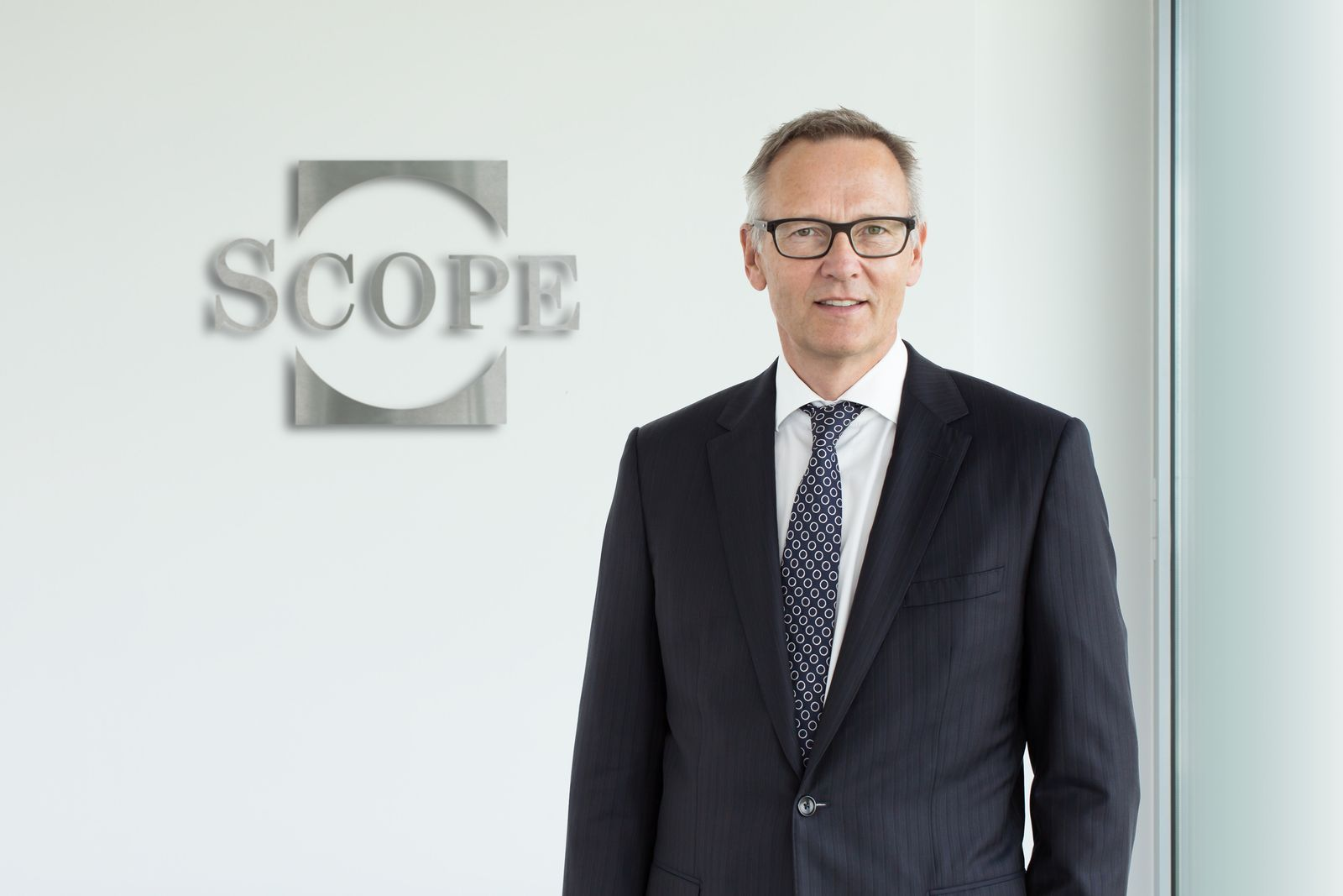 Torsten Hinrichs / Scope Logo