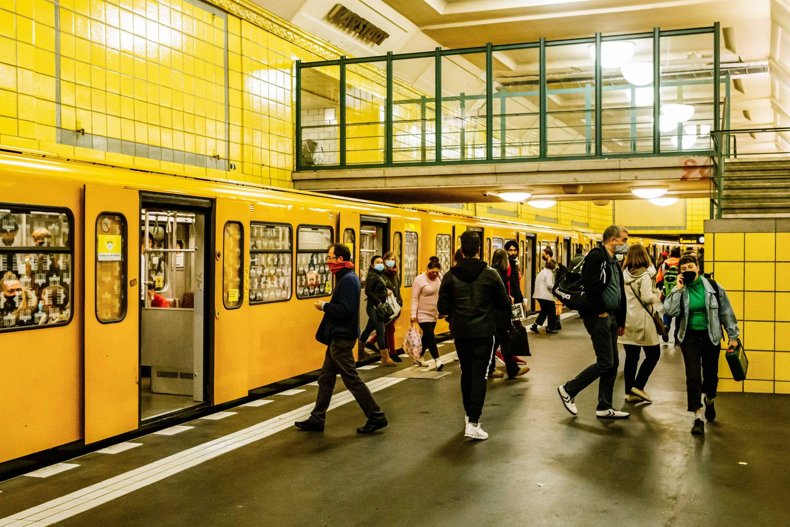 (201006) -- BERLIN, Oct. 6, 2020 -- Passengers are seen at a metro station in Berlin, capital of Germany, Oct. 5, 2020.