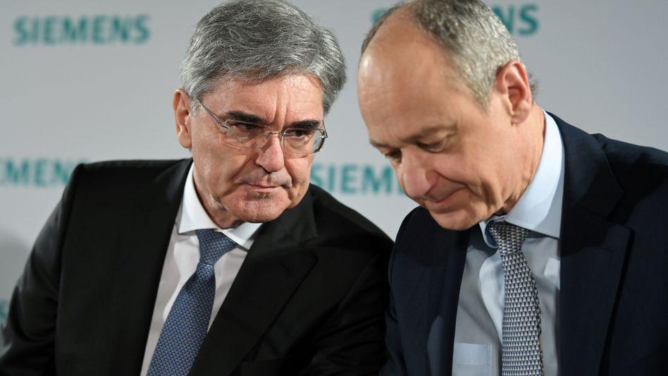 Siemens: Roland Busch (rechts) folgt im Februar auf Konzernchef Joe Kaeser. Michael Sen, der lange Zeit ebenfalls als möglicher Siemens-Chef gehandelt worden war, verlässt nach einem verlorenen Machtkampf den Konzern