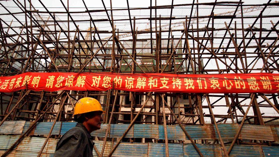 Baustelle in Peking: Die Regierung versucht, den überhitzten Immobilienmarkt abzukühlen