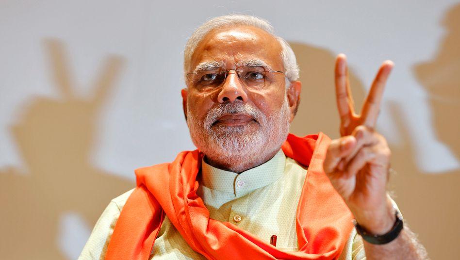 """Narendra Modi: """"Modi als Regierungschef im Bundesstaat Gujarat bewiesen, wie gut seine Politik wirken kann. Zudem wird er - das zeigt die absolute Mehrheit im Parlament - von einer breiten Stimmung im Land getragen"""""""