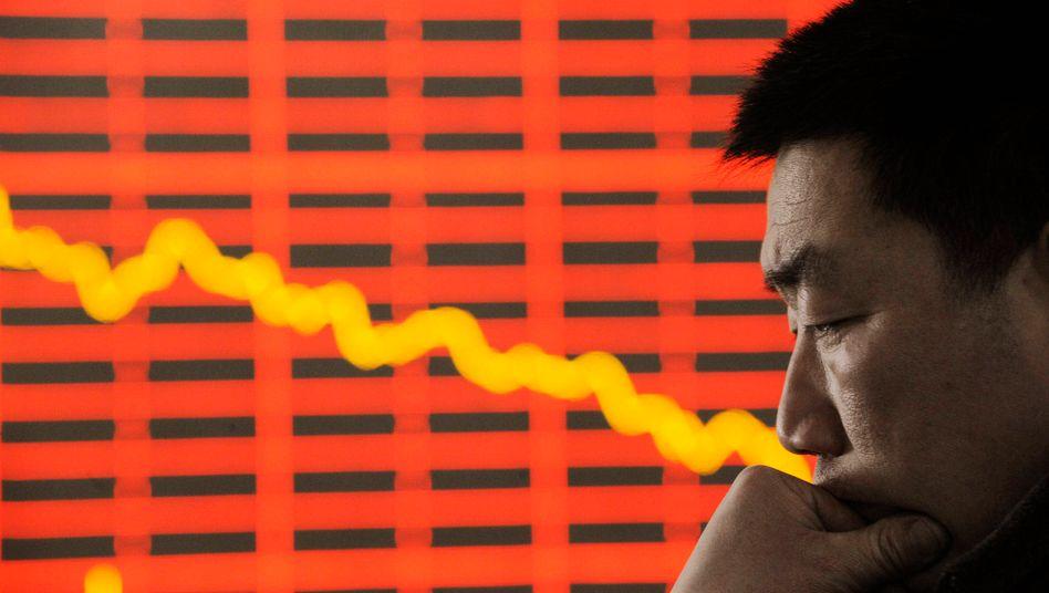 Nachdenklicher Chinese: Ein Kurssturz, da muss sich doch was machen lassen