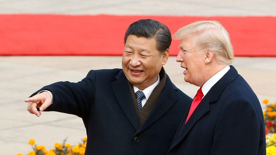 US-Präsident Donald Trump and Chinas Präsident Xi Jinping (Bild Archiv) wollen angeblich die Verhandlungen zur Befriedung des Handelskonflikts wieder aufnehmen