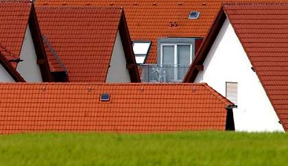 Geklont: Massenaufgebote industriell gefertigter Einfamilienhäuser haben nur dann eine Chance auf Werterhalt, wenn sie an eine Großstadt angebunden sind.