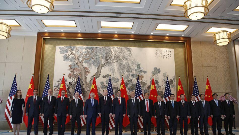 Die Verhandlungsteams aus China und den USA, darunter Finanzminister Steven Mnuchin, der Handelsbeauftragte Robert Lighthizer, sowie Chinas Vizepremier Liu He