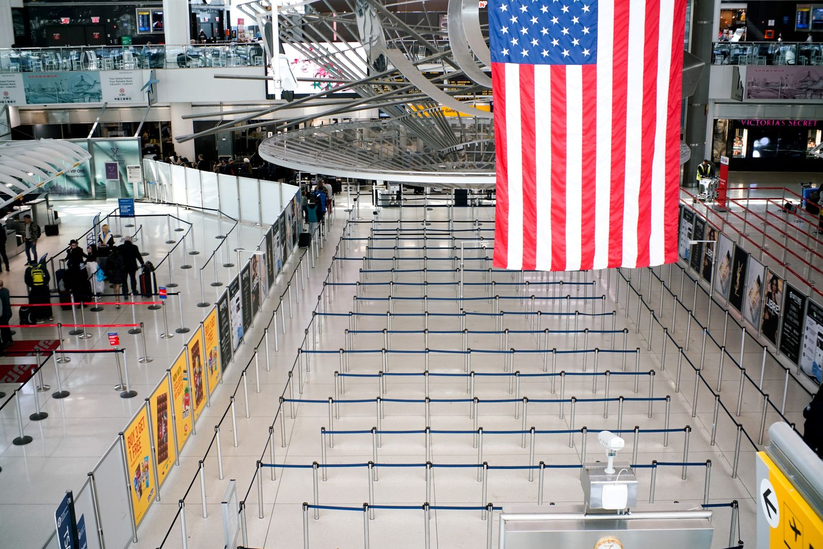The lines to reach TSA immigration process are seen empty at one of its terminals at the John F. Kennedy International Airport in New York