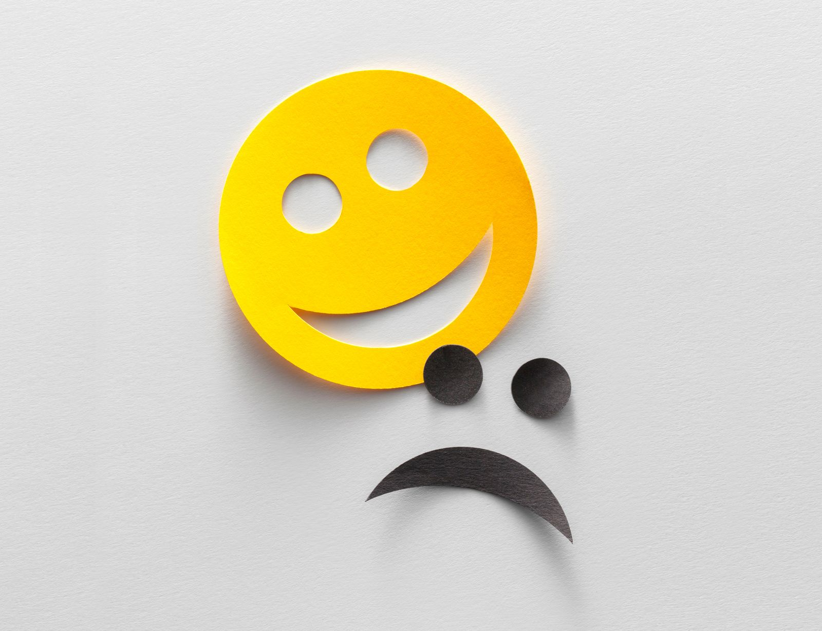 Happy and sad emoji smiley faces (or comedy and tragedy theater mask)